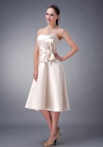 Simple Champagne Strapless Tea-Length Graduation Dress with Ruching and Bows