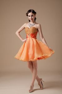 Cheap Orange Red A-line Sweetheart Graduation Dresses with Beading in Itasca