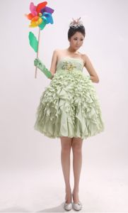 Popular Strapless Yellow Green Short Graduation Dress with Ruffled Hem